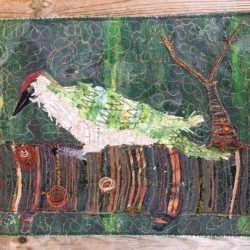 Woodpecker sounds in the garden (embroidery)